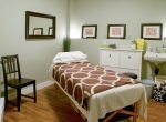 acupuncture treatment room with bed